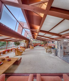 Roof overhangs allow light to fall in, but protect interior spaces from unwanted sunlight.  The redwood structure remains exposed on the interior, creating a seamless exterior to interior connection.