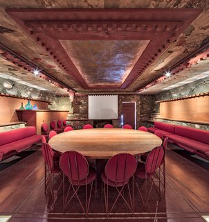 The Kiva Room, a half submerged underground space,  doubled as a Conference Room and Movie Theater for the Taliesin Fellowship.  Today, the space displays beauty and culture through craft and detailing.