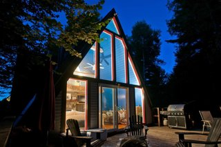 A cozy A-frame with views of Whiteface Mountain, this dwelling features a living room, fireplace, loft bedroom, and fully equipped kitchen.