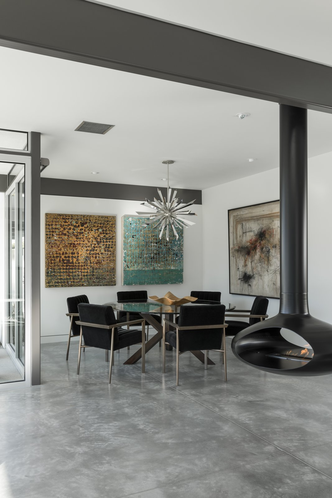 Dining, Concrete, Chair, Hanging, Table, and Ceiling Modern furnishings, a decorative metallic pendant, and colorful artwork decorate the dining space.  Dining Concrete Table Hanging Photos from The Last Donald Wexler–Designed Home Ever Built Asks $2.65M