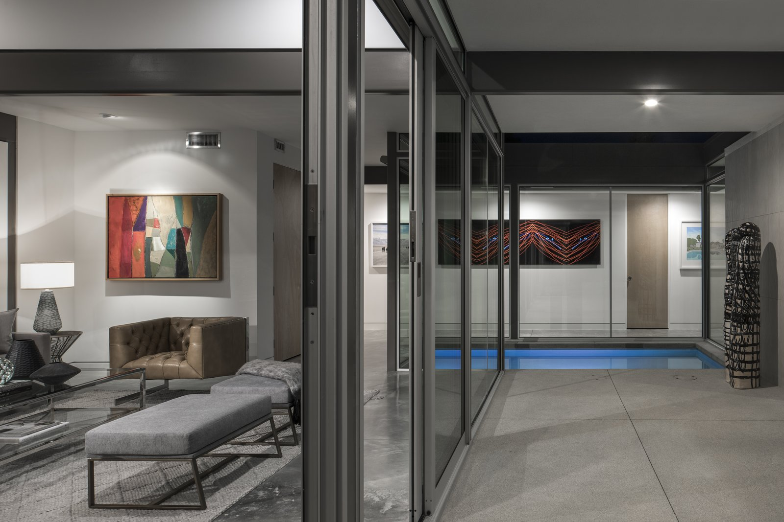 Doors, Exterior, Metal, and Sliding Further emphasizing the indoor/outdoor connection is a water feature which extends between spaces.  Best Doors Sliding Photos