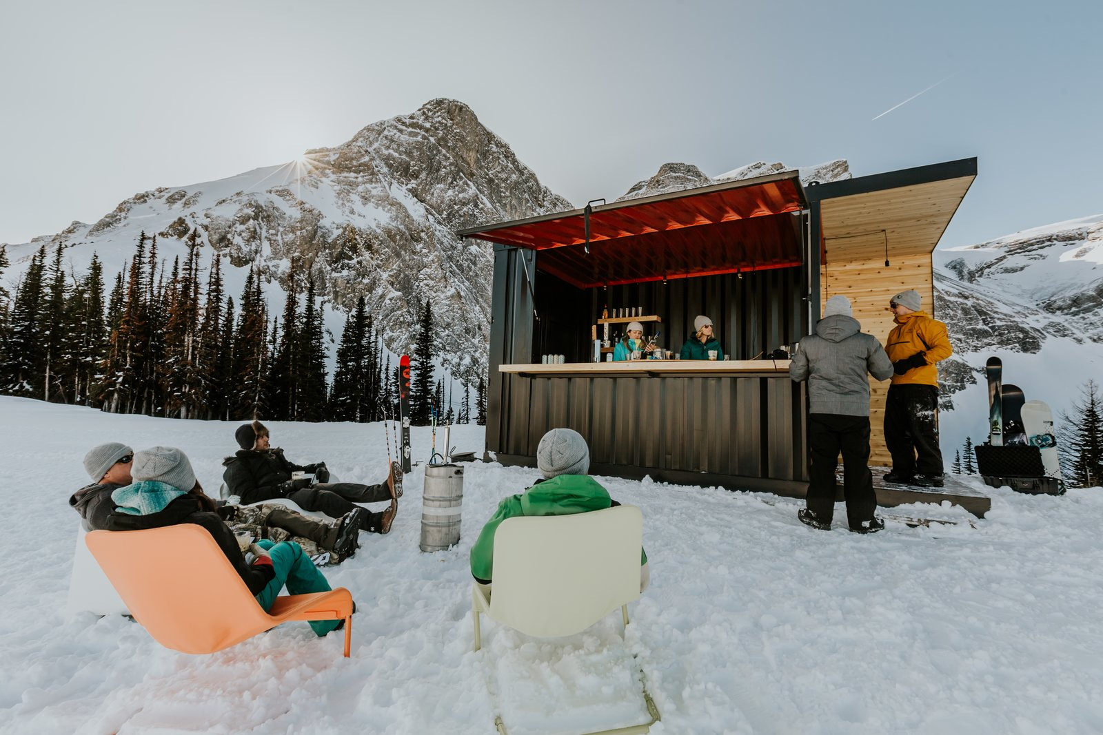 Exterior, Shipping Container, Wood, Metal, and Flat Outdoor enthusiasts gather at the bar for a quick relief from the downhill terrain.   Best Exterior Metal Shipping Container Photos from This Prefab Shipping Container Bar Can Pop Up Just About Anywhere