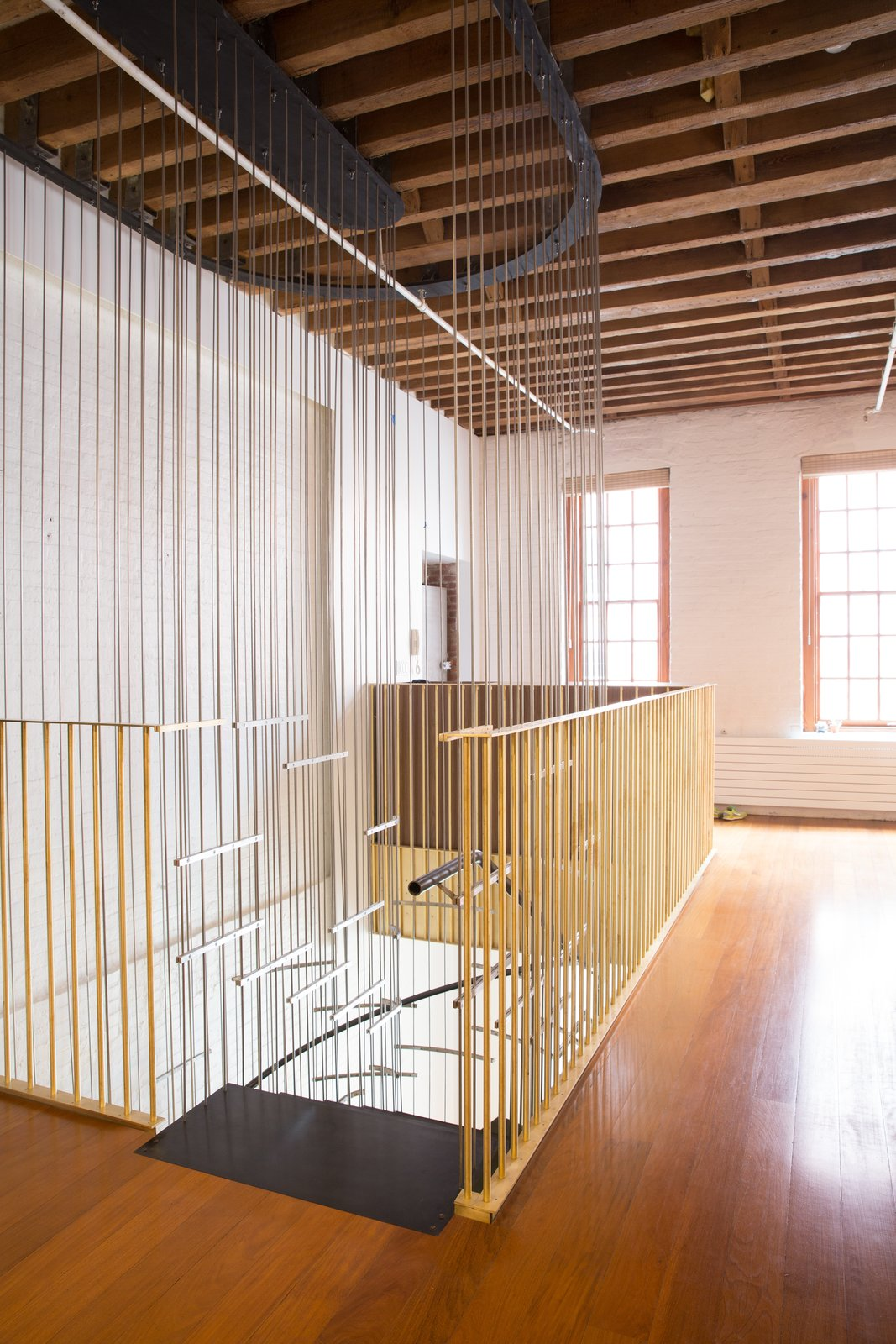 """Staircase, Metal Tread, and Metal Railing Architectural in use, the stair is also a sculptural composition of a palette of metals.   Search """"kitchencabinets--metal"""" from A Steel Staircase Merges Two Units Into One in Tribeca"""