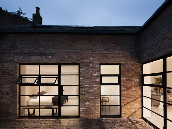 Gridded steel frame windows were added throughout the home to provide natural daylight to a city dwelling, unique for a London Residence of this type.