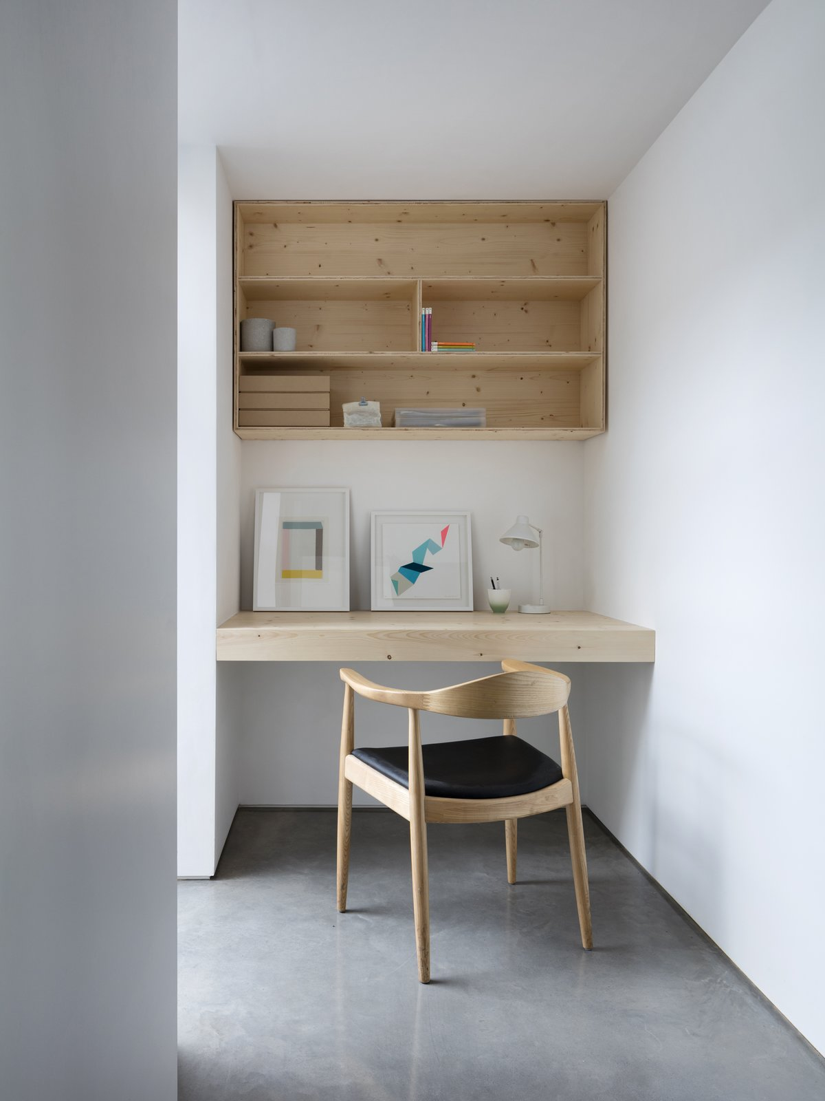 Office, Chair, Desk, Concrete Floor, and Shelves Custom built-ins provide functionality in every nook.   Photo 10 of 12 in A Forgotten Warehouse Is Reborn Into a Light-Filled London Home