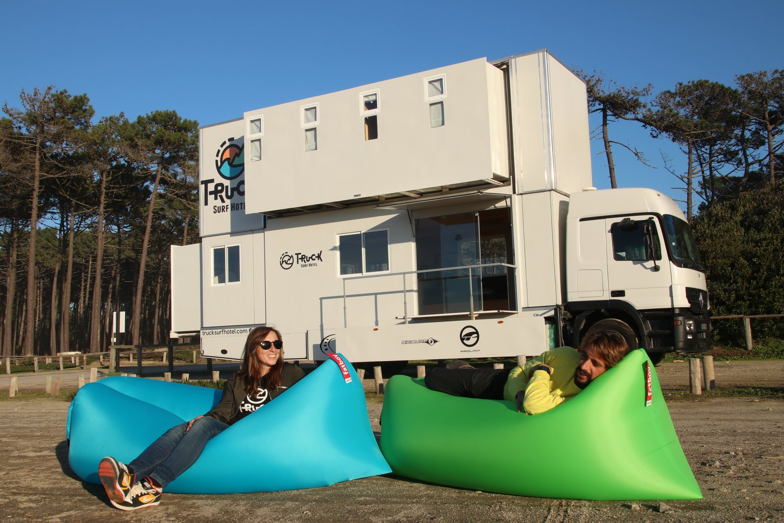 Outdoor and Front Yard Inflatable lounges are a travel-friendly way to soak up the sunshine.  Photo 11 of 11 in Get Your Surf On in This Traveling Truck Hotel