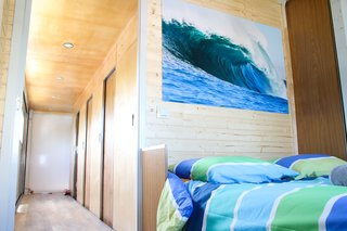 One double guest room anchors the upstairs sleeping quarters.  Beach-inspired colors and imagery draw the ocean in.