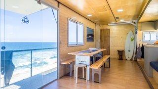 Large sliding glass doors draw in plenty of daylight while providing beachfront access.