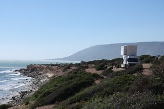 As the truck moves from spot to spot, it's sure to stop at the most scenic, ideal surfing locations. Windows on the second level provide ocean views for guests.