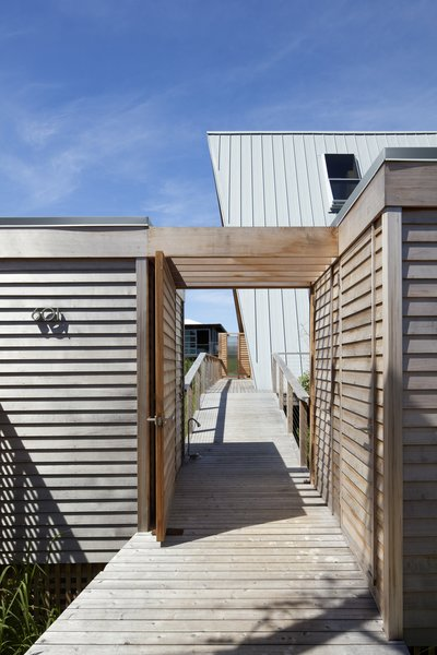 A wood promenade connects the beachside retreat directly to the bay.