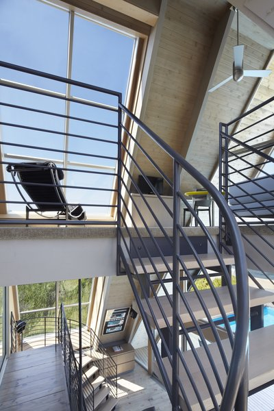 A framed view is provided atop each turn of the staircase.