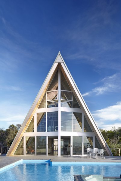 Architecture firm Bromley Caldari transformed a cramped beach house into a spacious vacation getaway filled with natural light and views.