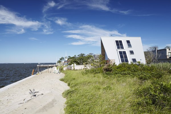 A Sculptural Staircase Anchors This A-Frame Getaway on Fire Island