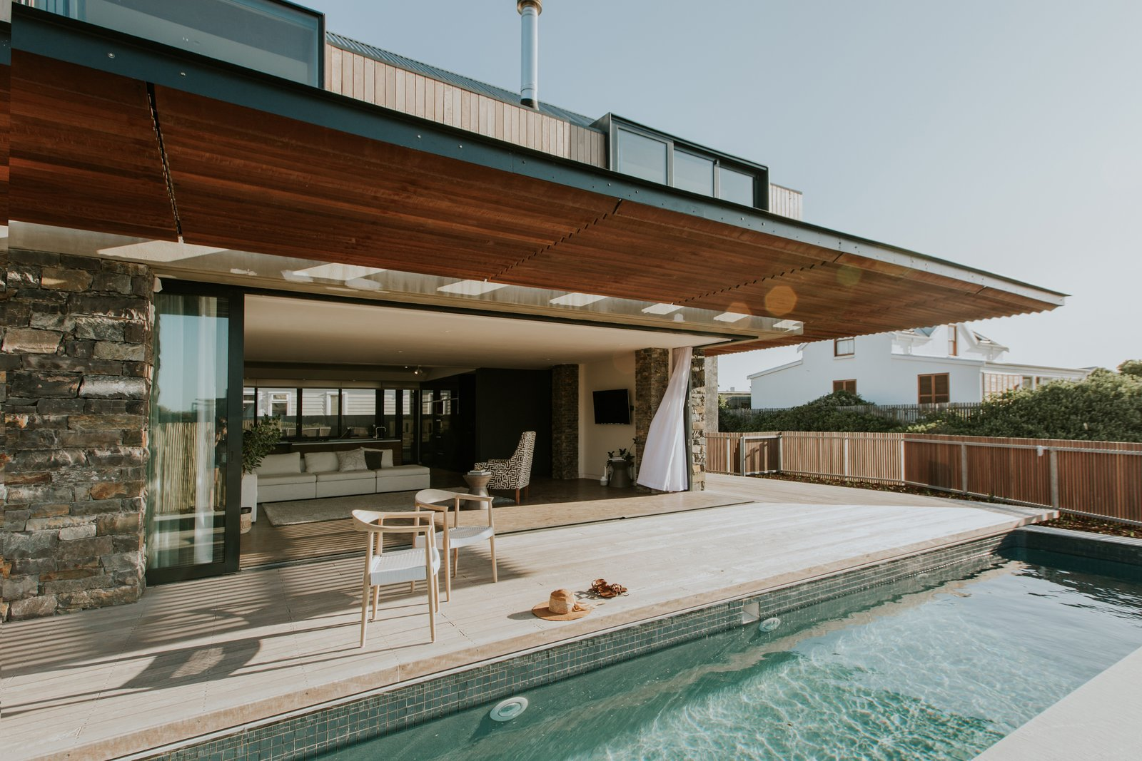 Outdoor, Wood, Large, Swimming, Large, and Wood The outdoor swimming pool is just steps from the comfort of the living spaces.  Best Outdoor Swimming Wood Photos from An Inviting South African Cottage Embraces its Seaside Locale