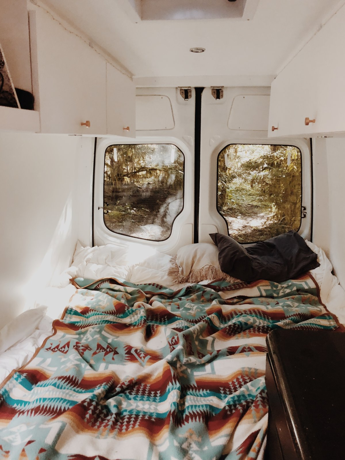 Bedroom, Recessed Lighting, and Bed A Pendleton wool blanket adorns the bed of a Mercedes Sprinter van.   Photo 7 of 12 in These Digital Nomads Live, Work, and Travel in a Sprinter Van