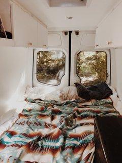 Memory foam pillows, a Pendleton wool blanket, and a memory foam mattress transformed the original van into the perfect nighttime retreat.