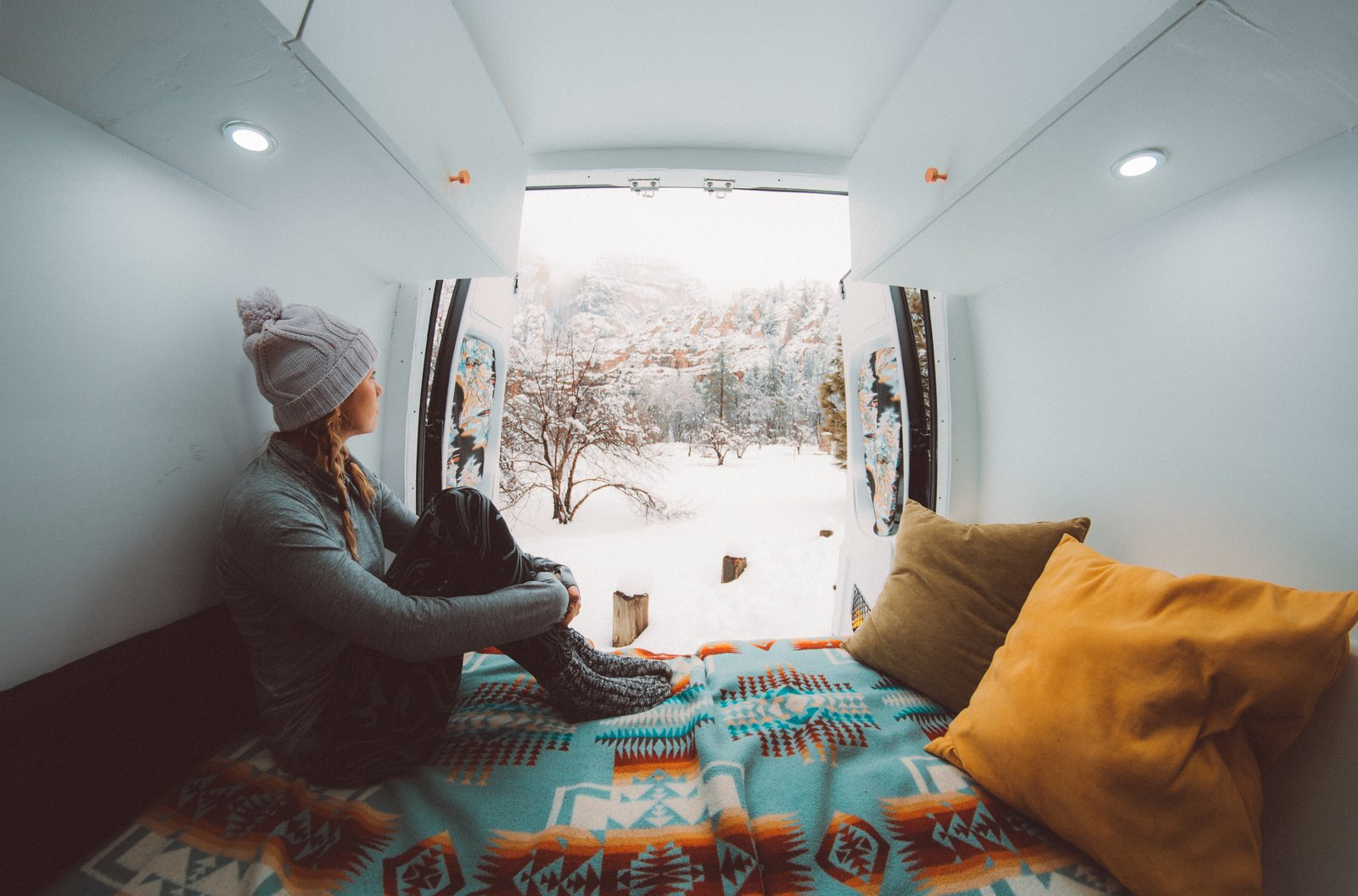 Bedroom, Bed, and Recessed Lighting Inside, flexible plywood walls concealed Denim Insulation, Reflectix, and a Vapor Barrier, which insulated the van from cooler temperatures.    Photo 8 of 12 in These Digital Nomads Live, Work, and Travel in a Sprinter Van