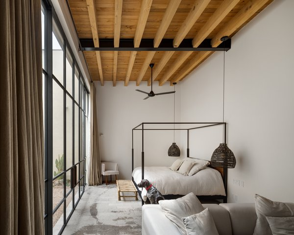 The furnishings and fixtures have all been selected with the notion of relaxation in mind. Natural materials, soft textiles, and neutral colors continue the muted palette of the construction.
