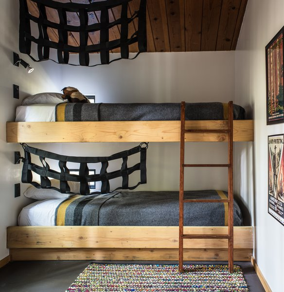 In the second bedroom, built-in bunk beds add a flair of fun, decorated with black netting.