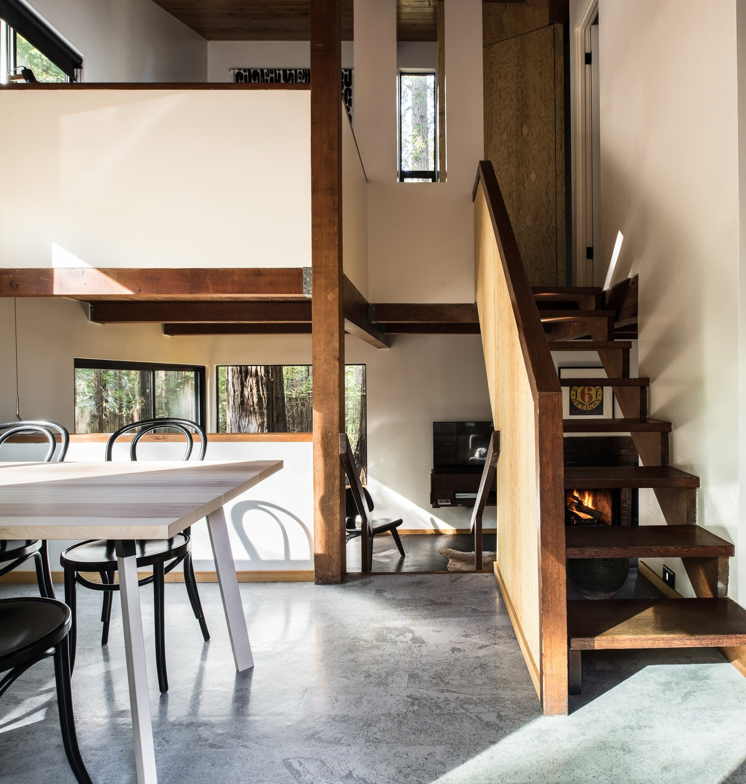 Dining Room, Chair, Table, and Concrete Floor Three levels intermix within the small footprint of the home, creating a loft-like feeling.   Photo 3 of 7 in A Midcentury Cabin at California's Sea Ranch Gets a Glowing Makeover