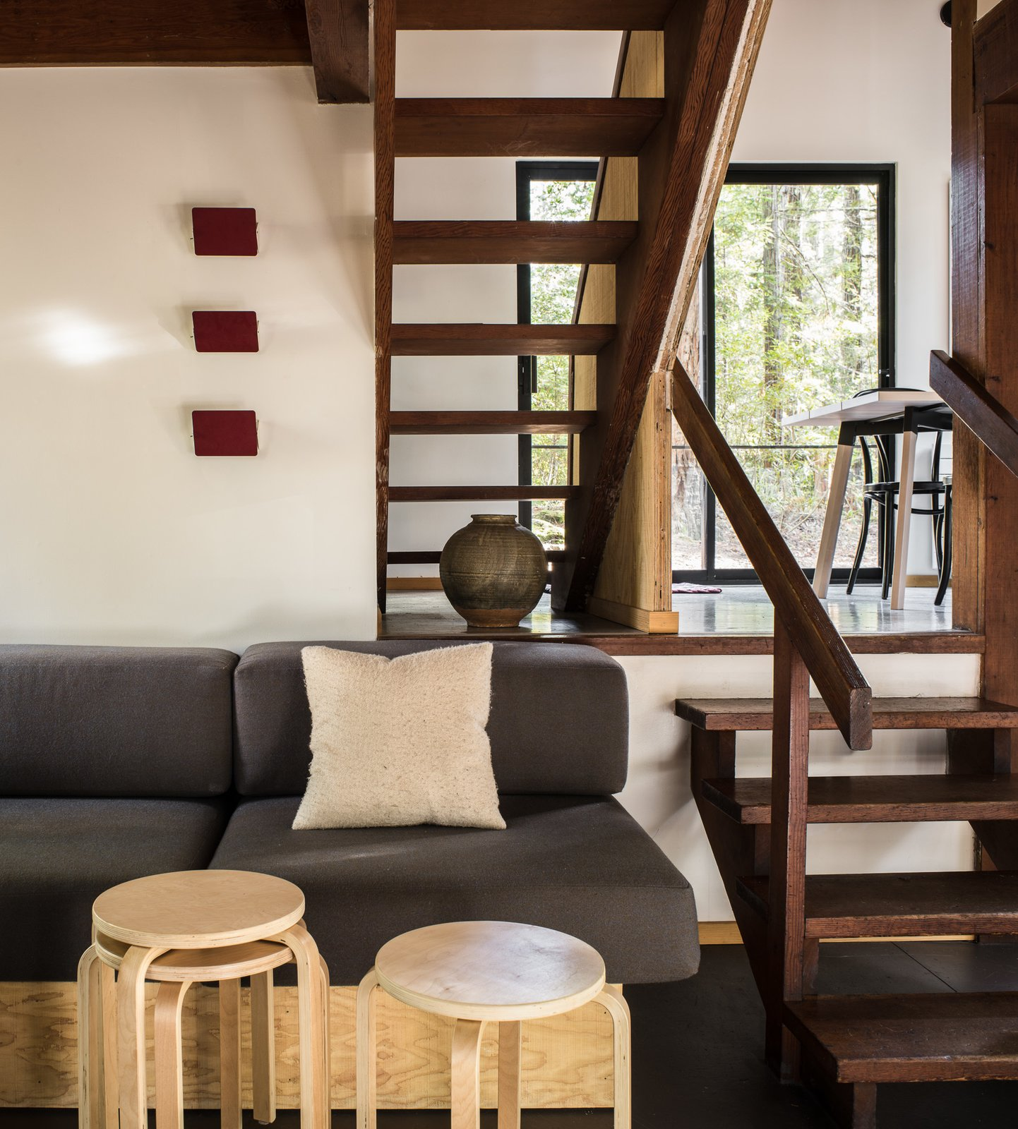 Staircase, Wood Tread, and Wood Railing Open wood stairs allow light to pass between levels.   Photo 2 of 7 in A Midcentury Cabin at California's Sea Ranch Gets a Glowing Makeover