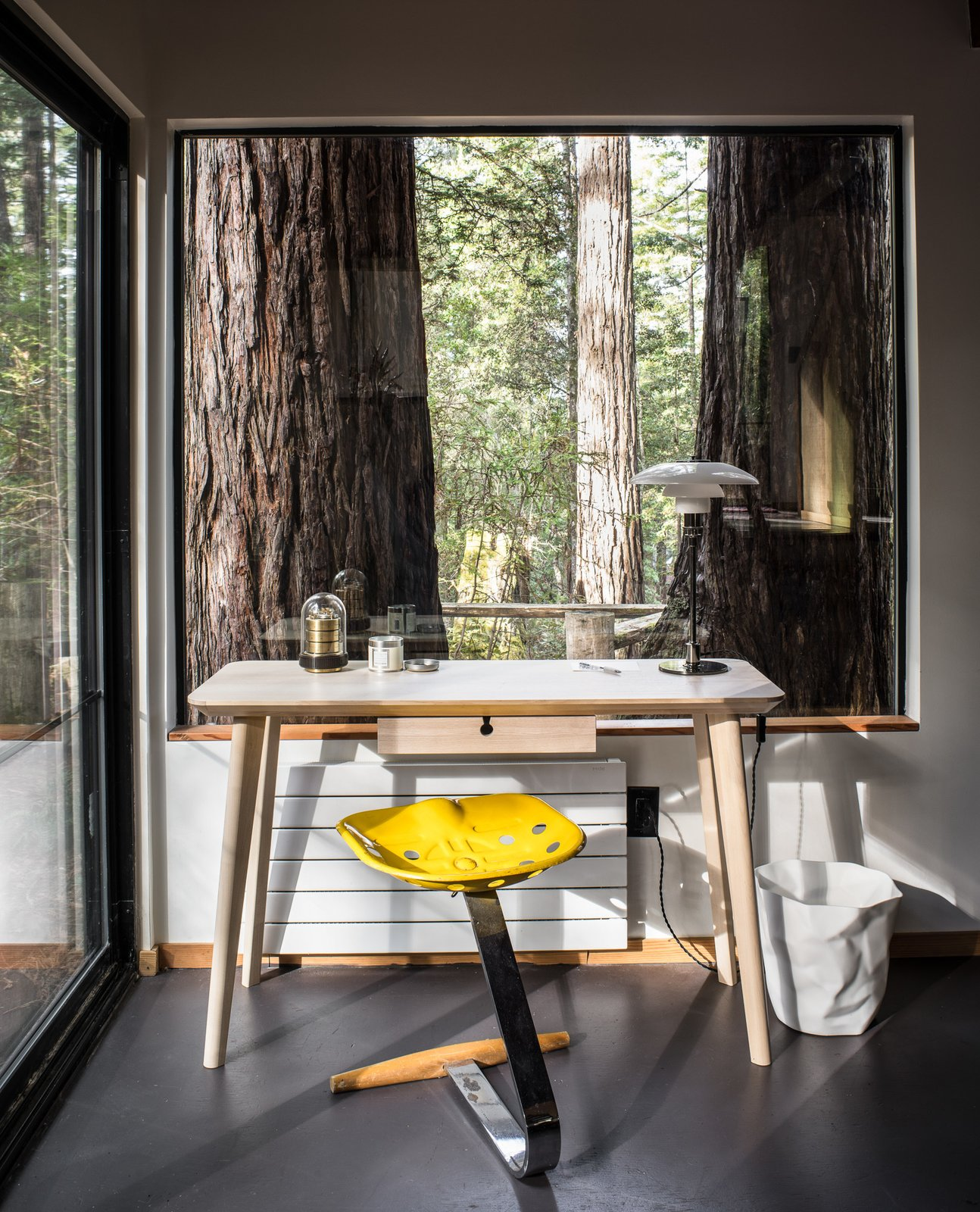 Office, Chair, Lamps, and Desk A small office spaces overlooks the redwood surroundings.   Photo 4 of 7 in A Midcentury Cabin at California's Sea Ranch Gets a Glowing Makeover