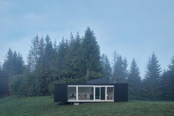 This Off-Grid Prefab Cabin Boasts a Hidden Hot Tub