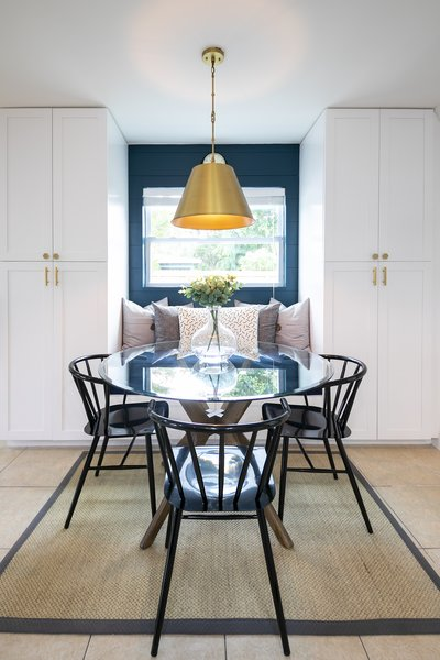 The deep blue color is extended into the dining space, and provides a colorful accent to the back wall of the seating area.