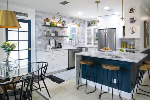 The re-organized layout provides an open, continuous flow between cooking, prep, and dining spaces.