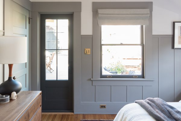 The new exterior door and adjacent window draw plentiful daylight into the bedroom space.