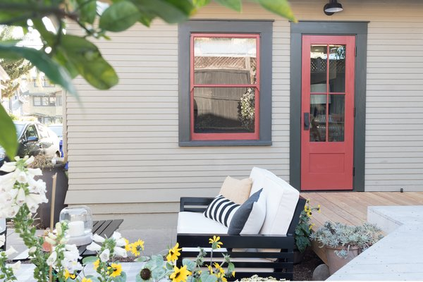 From the outside, the new door is matched to the exterior color palette, appearing as an original piece of the home.