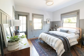 The new master bedroom is a mix of subtle colors, natural linens, wood textures, and curated artwork.