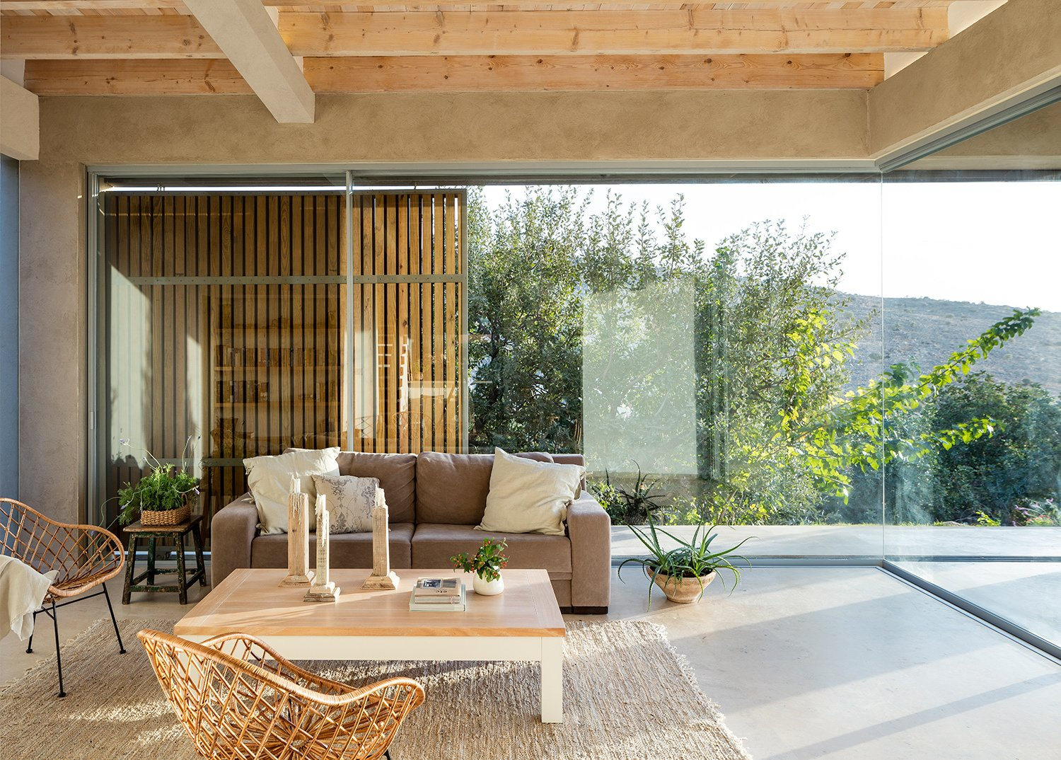 Living Room, Sofa, Chair, End Tables, Coffee Tables, and Rug Floor Expansive glazing provides continuous visual connections to the outdoors.   Photo 7 of 14 in Moveable Wooden Screens Add a Playful Touch to This Airy Home in Israel
