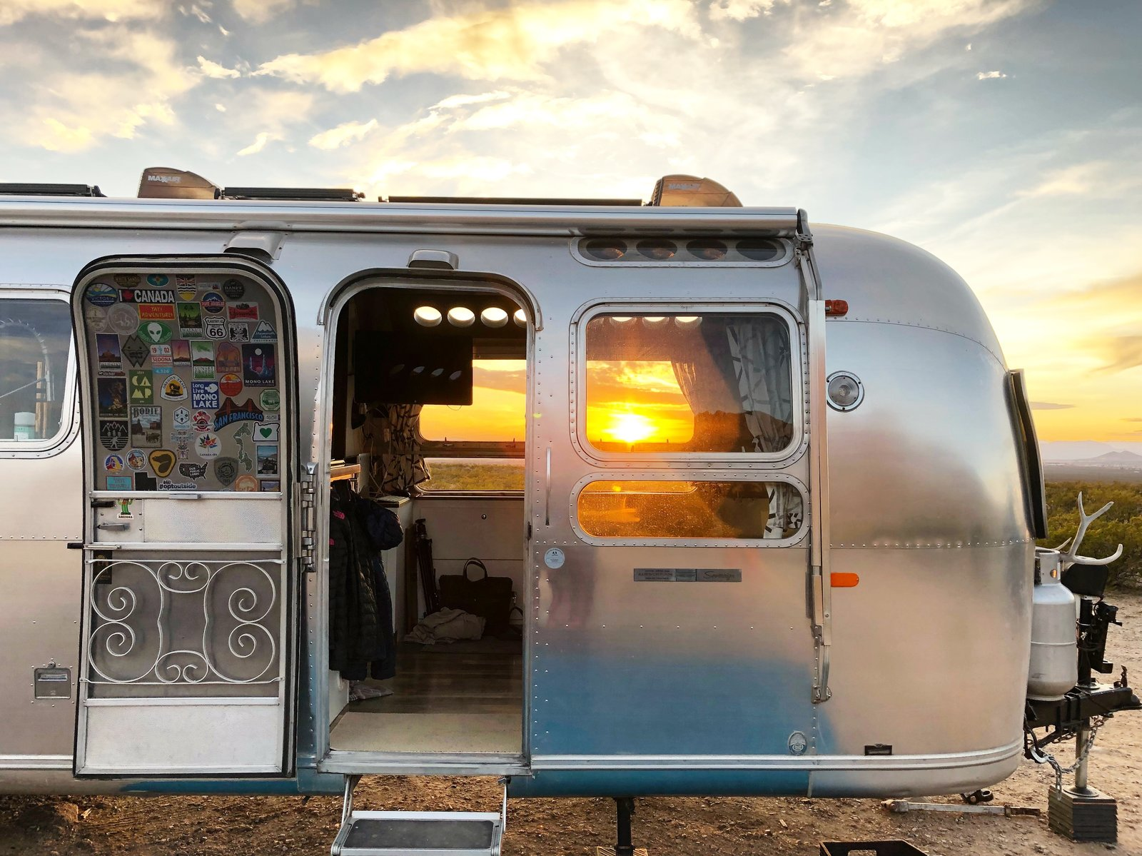 Exterior, Metal Siding Material, and Airstream Building Type Sunsets, breezes, and ocean views are just a small part of the experiences and adventures that this family now ensues.    Photo 11 of 12 in A 1970s Airstream Is Revamped Into an Off-Grid Home For Six from 1972 Vintage Airstream Trailer