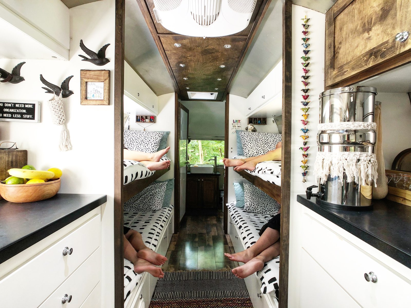 Bedroom, Storage, Medium Hardwood Floor, and Bunks The kids' fold-down bunk-beds are complete with Beddy's Bedding, which helps the space stay neat and organized.     Photo 6 of 12 in A 1970s Airstream Is Revamped Into an Off-Grid Home For Six from 1972 Vintage Airstream Trailer