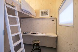 This small cabin provides plenty of sleeping space.  Below the built-in bunk lies a foldable bed, which can be converted into a table when not in use.