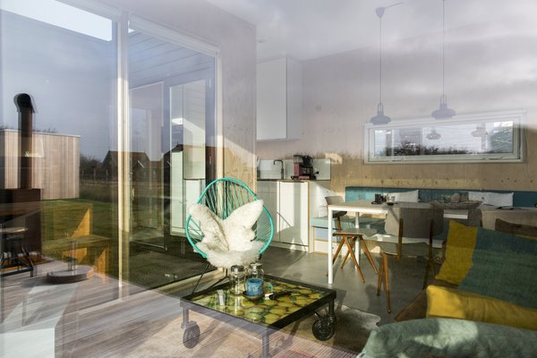 Expansive glazing creates a continuous visual connection between the interior living spaces and exterior patio.