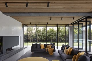 Continuous materials and expansive operable glazing blur the boundaries between interior and exterior, drawing the natural elements inward.