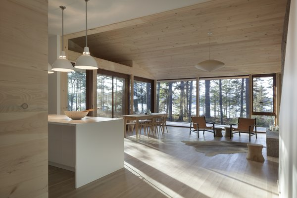A light, bright interior is filled with natural materials and white, subdued accents. Large windows look out towards the only fjord on the eastern seaboard.