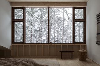The large windows in the master bedroom provide the feeling of sleeping within the tree tops.