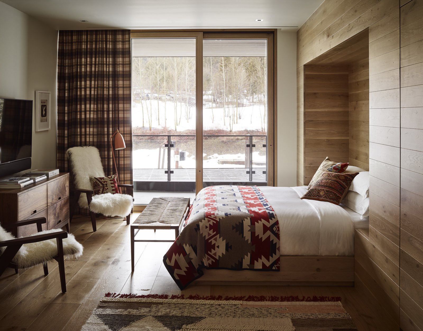 Bedroom, Light Hardwood, Recessed, Bed, Chair, Floor, Rug, and Bench Prints, plaids, and furs provide warmth and coziness, while introducing nods to he rugged American West.  Best Bedroom Recessed Light Hardwood Bench Photos from Caldera House