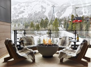 Each suite includes private outdoor balconies complete with fire pits.  Thanks to the snowmelt patios, you can enjoy this view and the great outdoors year round.