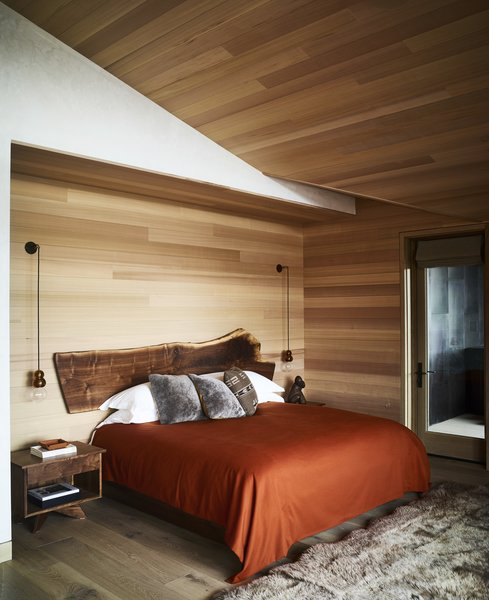Warm, rustic colors make bold statements against the calming, natural palette. No detail goes unnoticed - even the headboard is a custom-made creation that embodies modern rusticity.