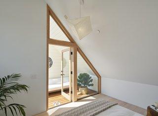 A quaint sun-deck becomes a hidden surprise off the master bedroom.