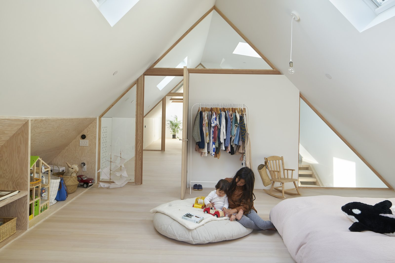 Kids, Pre-Teen, Bedroom, Rockers, Storage, Light Hardwood, Bed, Chair, Toddler, and Neutral Glazing allows visual transparency between spaces, as well as the passage of light from one end to the other, creating a bright, light-filled attic space.    Kids Chair Storage Photos from 15th Street