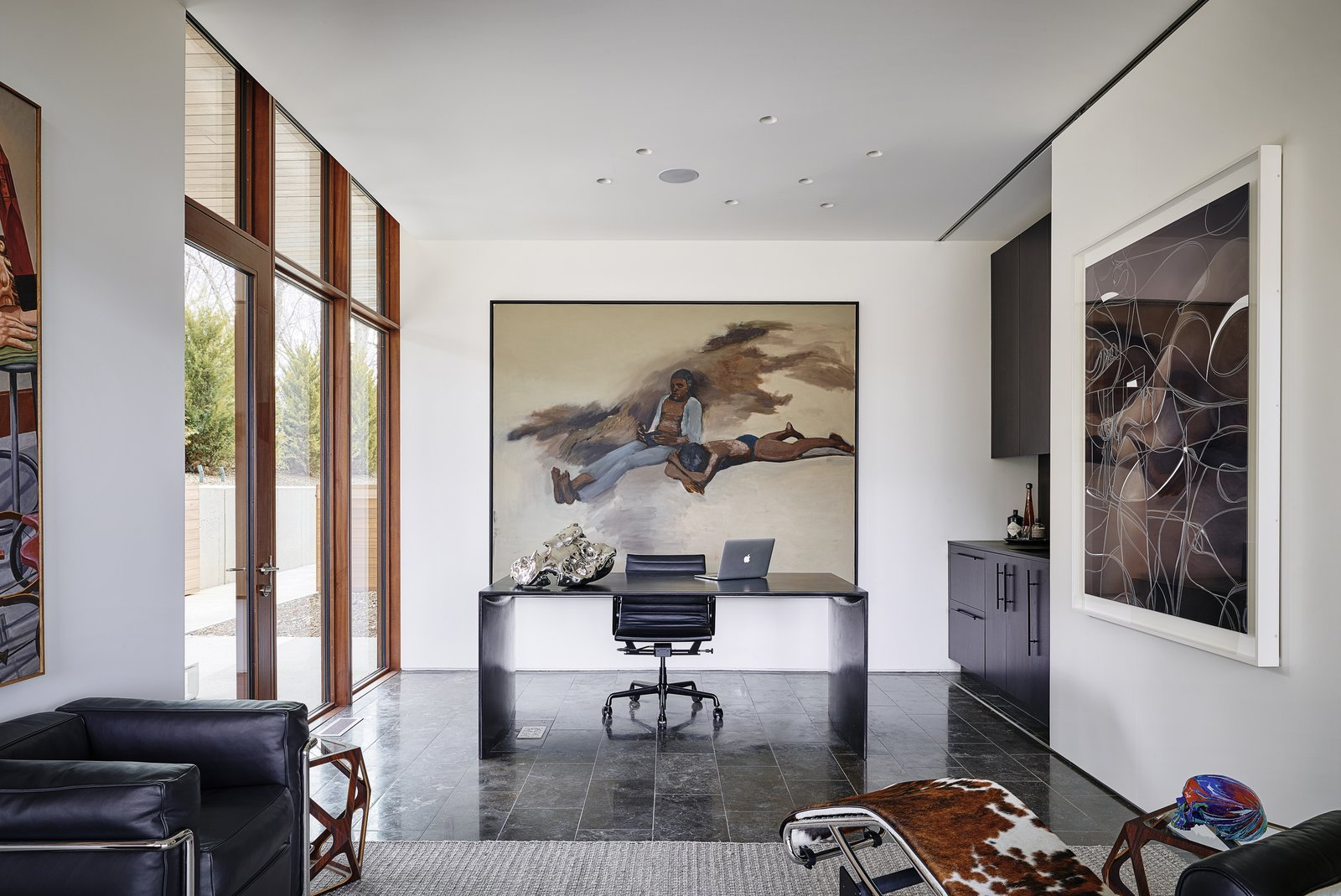 Office, Desk, Chair, Study Room Type, and Marble Floor Large spaces and blank walls allow the owners to modify and rotate artwork locations over time, creating an endless palette of wonder.     Photo 15 of 23 in A Luminous, Eco-Friendly Abode Is Completed With its Own Modern Art Gallery from Artery House