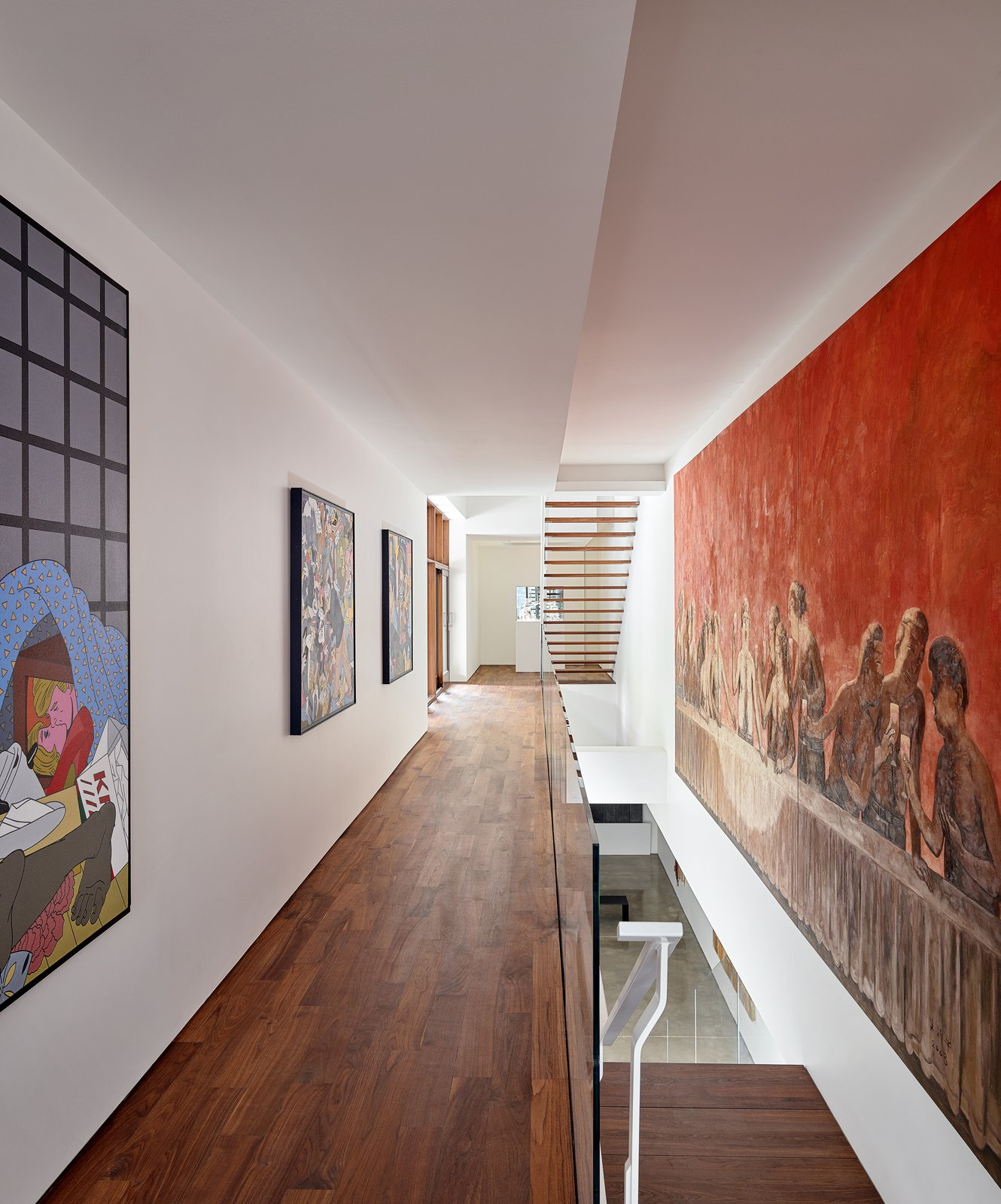 """Hallway and Medium Hardwood Floor The circulation spaces are the """"arteries"""" of the home, spreading color and artwork throughout the property.    Artery House"""