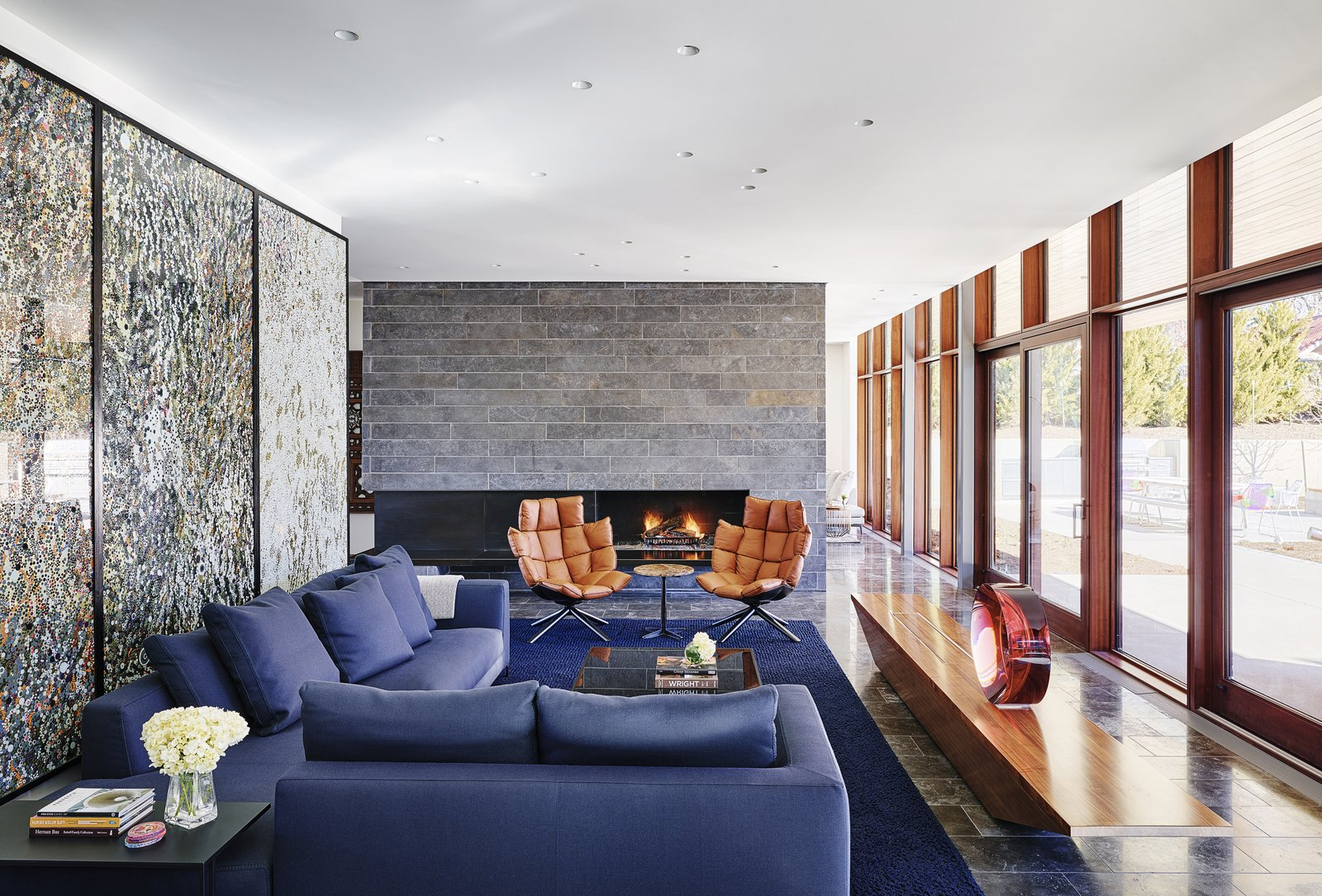Living Room, Sectional, Coffee Tables, Wood Burning Fireplace, Recessed Lighting, Chair, and Ceiling Lighting A sitting area, complete with a fireplace, is located at the center of the home. Large windows provide direct visual connection to the landscape.     Artery House