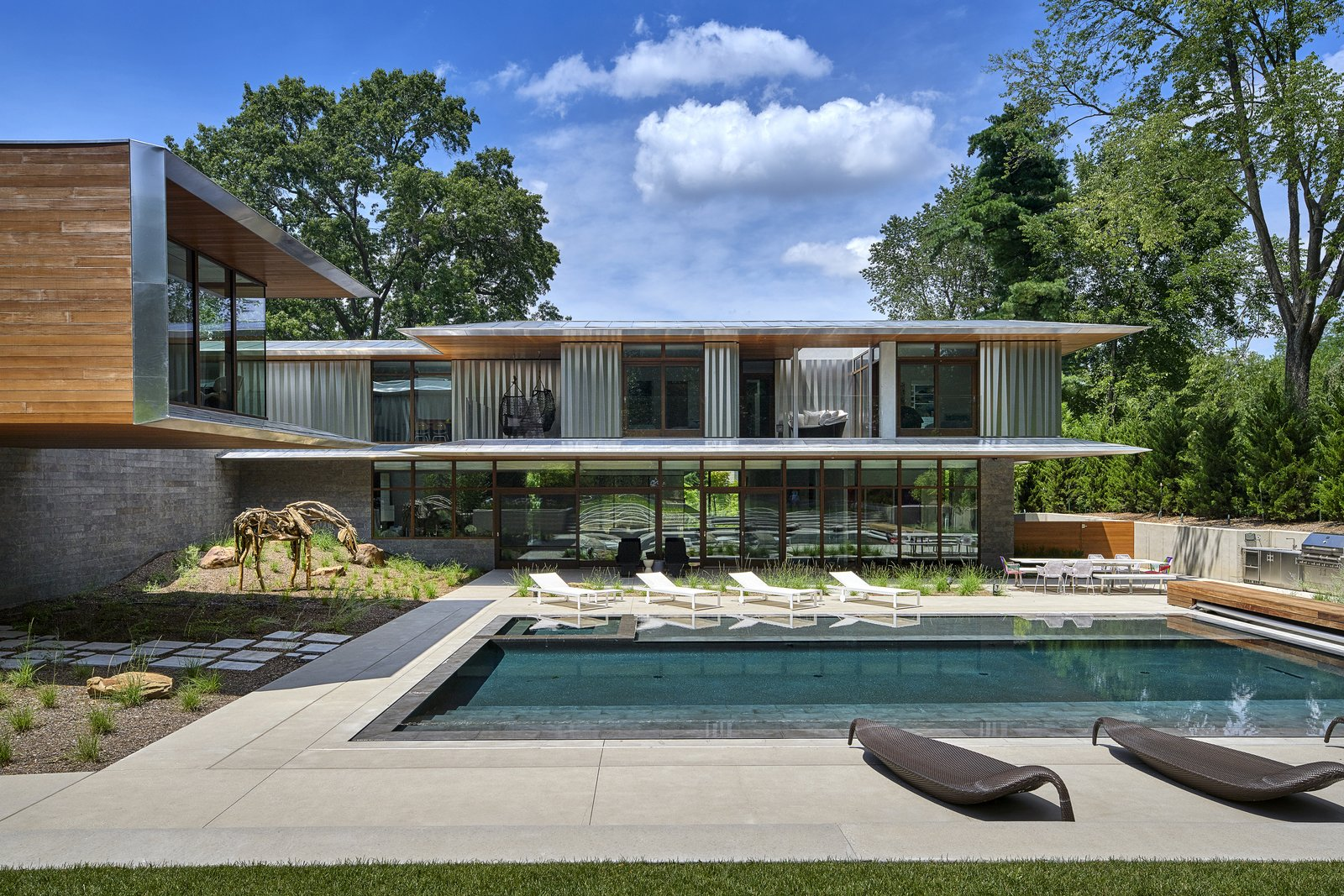 Outdoor, Swimming Pools, Tubs, Shower, Large Pools, Tubs, Shower, Concrete Patio, Porch, Deck, Grass, Back Yard, and Hardscapes The custom aluminum screens bend and fold like a curtain as they wrap the second floor exterior.  Artery House