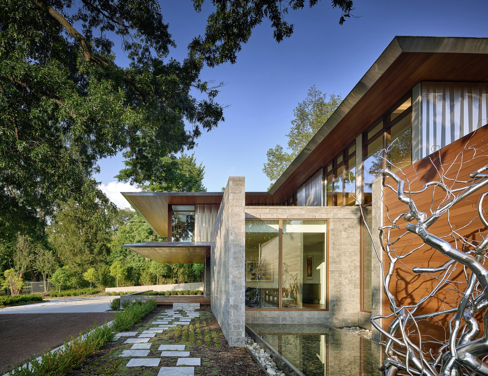 Exterior, Wood Siding Material, Stone Siding Material, Metal Roof Material, House Building Type, Metal Siding Material, Flat RoofLine, and Brick Siding Material House and art gallery, this private residence is full of special moments of awe and admiration.  Artery House